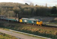 One of the two Cumbrian Coast Class 37 diagrams was supposed to move to Class 68 haulage before the end of January 2018 but two 37s continued in use during the first week of February. 37424 <I>Avro Vulcan XH558</I> propels the 2C32 Carlisle to Preston service at Morecambe South Junction on a sunny 2nd February 2018. <br><br>[Mark Bartlett&nbsp;02/02/2018]