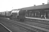 The appearance of 60117 <I>Bois Roussell</I> appears to have delighted one of the platform souls at Doncaster station on 21 July 1962. The Copley Hill A1 Pacific (named after the winner of the 1938 Derby) runs south through the centre road with a Saturday Leeds Central - Kings Cross express.   <br><br>[K A Gray&nbsp;21/07/1962]