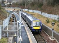 The 0911 Edinburgh - Tweedbank pulls away from the well gritted platform at Gorebridge on a chilly 18 February 2018. The Sunday morning service is formed by ScotRail 170477. <br><br>[John Furnevel&nbsp;18/02/2018]
