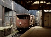 An unidentified Clayton Type 1 waits for the road at Waverley's platform 21 with a single container and ex-LMS brake van in the early 1970s.<br> <br> <br><br>[Bill Roberton&nbsp;//1970]