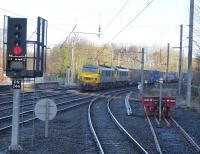 Freightliner 90041 & 90045 take the Up Fast line through Lancaster with a Coatbridge to Daventry intermodal service on the morning of 18th February 2018. The buffers on the right sit on the formation of the chord to Lancaster Green Ayre, closed in 1966. <br><br>[Mark Bartlett&nbsp;20/02/2018]