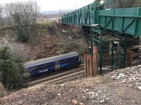 The 1007 to Dalmuir passes under the temporary pedestrian bridge on its approach to Baillieston on 22nd February 2018. The Muirhead Road overbridge which is being replaced had been reduced  to a single carriageway with a weight restriction some years before.<br><br>[Colin McDonald&nbsp;22/02/2018]