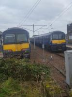 Two Class 320 EMUs at Lanark on 21st February 2018. On the right an original Scottish set and on the left one of the refurbished ex-London Midland sets.<br> <br><br>[John Yellowlees&nbsp;21/02/2018]
