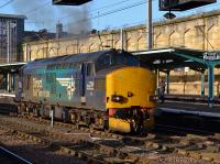 DRS 37218 opens up after a signal check, on its way from Kingmoor to Crewe, one of three Class 37s seen in the station in a 30 minute period on 21st February 2018.<br> <br> <br><br>[Bill Roberton&nbsp;21/02/2018]