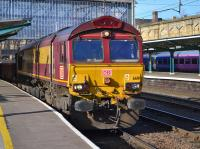 DBS 66111 passes Platform 3 at Carlisle Citadel with a ballast from Kingmoor to Tyne Yard on 21st February 2018.<br> <br> <br><br>[Bill Roberton&nbsp;21/02/2018]