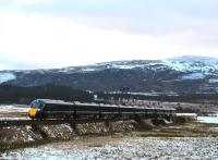 GWR liveried Hitachi Class 800 Azuma, No. 800303 forms the 5X71 ECS working from Craigentinny to Inverness crossing the freezing cold moor at Moy on 27th February 2018. (Strictly as GWR, this is a InterCity Express Train (IET) rather than Azuma - thank you WC.)<br> <br> <br><br>[John Gray&nbsp;27/02/2018]
