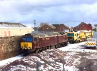 WCRC 57316 and a track machine stabled in the up siding behind Arbroath signal box on 28 February 2018.<br><br>[Sandy Steele&nbsp;28/02/2018]