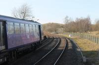 A Northern Class 144 Pacer, possibly in its last year of service, leans on the sharp curve as it waits to depart from Clapham with a Leeds to Morecambe service in February 2018. The silver birch trees directly ahead sit on the trackbed of the old line through Ingleton to Low Gill on the WCML, which lost its local services in 1954 but only closed completely in 1966. <br><br>[Mark Bartlett&nbsp;24/02/2018]
