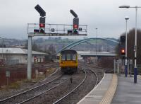 Pacer 142041 leaves Blackburn with a Colne to Preston stopping service on 14th February 2018. This is probably the unit's last full year of operational service. The signals control the junction with the Bolton line, which diverges near the large road bridge.  <br><br>[Mark Bartlett 14/02/2018]