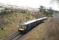 The 0911 Edinburgh - Tweedbank passing new housing to the south of Gorebridge, shortly after leaving the station on 18 February 2018. Another significant housing development is underway off to right between the railway and the A7. The train will shortly pass below a footbridge constructed during the Borders Railway project as part of this planned expansion [see image 54218]. <br><br>[John Furnevel&nbsp;18/02/2018]
