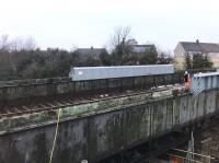 Double take time - what at first glance might appear to be railway track across the Muirhead Road overbridge is in fact the corrugated metal of the deck, now exposed on the southern part of the bridge, with a pipe pretending to be a length of rail. <br><br>[Colin McDonald&nbsp;05/03/2018]
