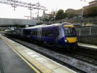 Its 12th December 2017 and some EGML services had just been temporarily put into the hands of seven-car Class 380s. Three out of four were still diesel however, and a Class 170 calls at Polmont with a Glasgow service. At time of writing, 27 February 2018, nothing has changed and there's no firm date for full electric services.<br><br>[David Panton&nbsp;12/12/2017]