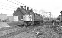 Class 40 40138, north bound with cement wagons at Beattock station in the 1970s.<br><br>[Ian Millar&nbsp;//1970]
