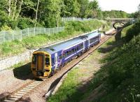 A fine May morning in 2016 sees 158727 run through the abandoned platforms of the original Eskbank station with a northbound train on the Borders Railway. <br><br>[John Furnevel&nbsp;22/05/2016]