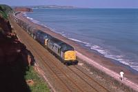 Holiday memories: 37890 and 37248 head westwards at Dawlish on 3rd July 1998. 37248 is now preserved on the Gloucester and Warwickshire Railway but 37890 was scrapped in Rotherham.  <br> <br><br>[Graeme Blair&nbsp;03/07/1998]