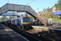 320305 approching Westerton with a Dalmuir to Larkhall service on 2nd November 2017. How long will the footbridge last after the new lifts and stairs are completed?<br> <br> <br><br>[Alastair McLellan&nbsp;02/11/2017]