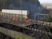 The old Muirside Road overbridge at Baillieston station being cut up <i>in situ</i>. The road is due to reopen in September 2018. <br><br>[Colin McDonald&nbsp;11/03/2018]