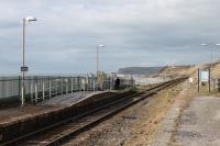 Nethertown station was a passing loop until the 1970s but only one platform is in use now. This remote but atmospheric halt on the Cumbrian Coast sees four 'on request' services each way on weekdays. This was the scene on a sunny 8th March 2018, looking towards St Bees Head, with two passengers waiting for the train. <br><br>[Mark Bartlett&nbsp;08/03/2018]