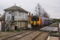 An EMT service to Nottingham has just departed Newark Castle station as it passes the signalbox and LC on 18 February 2018.<br><br>[John McIntyre&nbsp;18/02/2018]