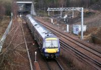 ScotRail 170450 is about to come off the Borders line at Newcraighall North Junction with the 0845 Tweedbank - Edinburgh Sunday service on 11 March 2018. The train is slowing for the stop at Newcraighall station just beyond the bridge.<br><br>[John Furnevel&nbsp;11/03/2018]