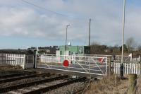 Kirksanton, one of two level crossings just north of Millom, is manually operated by a gatekeeper based in the green hut who also controls protecting semaphore signals. There was a station here very briefly but it closed in 1857.  <br><br>[Mark Bartlett&nbsp;09/03/2018]