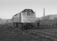 A BR Class 25 arrives at the Cutler Sidings, Waterside, with empty wagons on 20th December 1977.<br> <br> <br><br>[Bill Roberton&nbsp;20/12/1977]
