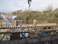 Piece by piece removal of the old Muirhead Road overbridge in progress in mid March 2018. As the demolition proceeds southwards, sections of the supports for the new bridge are being installed from the north side.<br><br>[Colin McDonald&nbsp;//]