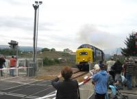 A photograph taken at Waterside Level Crossing, Causewayhead, on the re-opening of the Stirling - Alloa - Kincardine line. Deltic 55022 <I>Royal Scots Grey</I>. [Ref query 23 March 2018]<br><br>[Hamish Baillie&nbsp;15/05/2008]