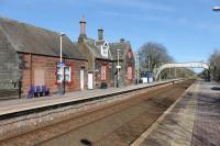 Aspatria station, seen on a sunny 9th March 2018 looking towards Carlisle. The station building is in private use and this is a request stop nowadays.  <br><br>[Mark Bartlett&nbsp;09/03/2018]