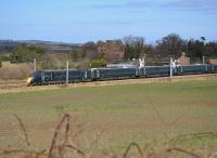 GWR-liveried 800004 passes Redhouse Castle, a little east of Longniddry, with a Doncaster - Edinburgh training run.  Seen from the Haddington branch embankment.<br><br>[Bill Roberton&nbsp;19/03/2018]
