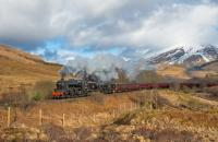 I could hear this working hard climbing Glen Falloch long before I could see it. 44871 and 45407 (with 37517 at the rear) have just cleared the Crianlarich Viaducts and are turning west to run along Strath Fillan. A snowy Ben More provides the backdrop.<br><br>[Ewan Crawford&nbsp;28/03/2018]