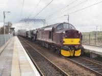 37518 leads 44871 and 45407 westwards through Gartcosh station with a stock movement from Carnforth to Fort William.<br><br>[Ian Millar&nbsp;28/03/2018]