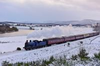 It is mid afternoon on 11th December 2017 and already the light is going as Caledonian Railway 0-6-0 No.828 approaches Broomhill with the second Santa Express of the day. In the background snow clouds gather and, on the left, light reflects off the River Spey.<br><br>[John Gray&nbsp;11/12/2017]