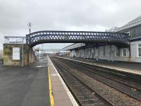 The lattice footbridge from platforms 6–9 which Network Rail plans to replace with a fully accessible structure. The new bridge will also permit electrification of these platforms. The photo was taken during a 4 week closure of the Stirling–Alloa line for engineering works.<br><br>[Colin McDonald&nbsp;23/03/2018]