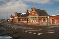 Outside view of the former Barry Island station building. It is all locked up for the winter but there are signs for a station cafe.<br><br>[Alastair McLellan&nbsp;19/03/2018]