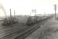 Scene at Hurlford looking south on 22 May 1961. Horwich Mogul 42905 is about to pass with a down coal train, while classmate 42834 waits in the shed sidings.    <br><br>[G H Robin collection by courtesy of the Mitchell Library, Glasgow&nbsp;22/05/1961]