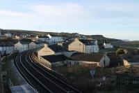 Early morning at Harrington on 9th March 2018 with the rising sun illuminating the scene. This view looks south from the station footbridge along the line towards Parton and Whitehaven and should have included a Cass 37 hauled passenger train but that had failed at Sellafield. <br><br>[Mark Bartlett&nbsp;09/03/2018]