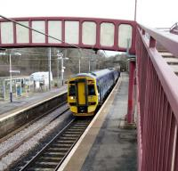 A Glasgow service halts at Curriehill on 28th March 2018. It might have been a better marketing move to give this station its original name of Currie when it reopened in 1987, rather than its last name. After all the other Currie, on the branch, had closed 44 years earlier and it's unlikely anyone would confuse them.<br><br>[David Panton&nbsp;28/03/2018]