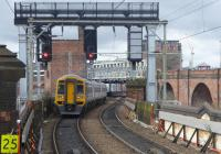158754, on a Manchester Oxford Road to Selby service, passes Castlefield Junction on 27th March 2018 heading for the new Ordsall Chord link to Manchester Victoria and the Calder Valley route. This view looks west from the platform at Deansgate. The CLC route diverges left at this point and on the right of the picture the old Midland lines, now Metrolink, climb to cross the Network Rail tracks. <br><br>[Mark Bartlett 27/03/2018]