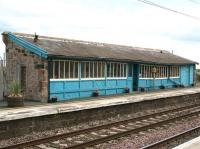 The attractive waiting room at Chathill, Northumberland, photographed looking east across the ECML from the down platform in October 2012. Doubtless a boon in bad weather for passengers using the morning or evening train south. There is no waiting area on the down platform as both northbound daily services terminate here. [See image 16285]<br><br>[John Furnevel&nbsp;08/10/2012]
