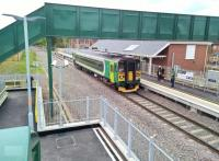 The 11.08 to Coventry slows to pick up at Kenilworth on its opening day. An orange sign in the windscreen said 'Welcome back Kenilworth'.<br><br>[Ken Strachan 30/04/2018]