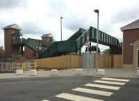 A small collection of footbridges at Kenilworth. That on the left is the new station footbridge; that on the right carries a footpath.<br><br>[Ken Strachan 30/04/2018]
