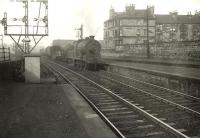 Ex-NB J37 0-6-0 64563 approaching from Pollok Junction and about to run through Shields Road station on 22 September 1956. The freight is on the down St Enoch route [see image 16340].