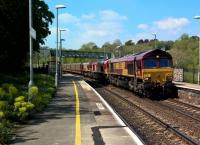 Every Saturday, there are one or two coupled processions of three or four Class 66s running from South Wales (Newport ADJ or Margam) to Eastleigh for servicing (e.g. refuelling). In this shot on 5th May 2018 a colourful sandwich of EWS 66221, DB 66131 and EWS 66013 haul empty car carriers from Alexndra Dock Junction to the South Coast. My first freight shot at Freshford, after visiting for some six years!<br><br>[Ken Strachan 05/05/2018]