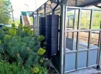 If I told you there were two water tanks at Freshford, you probably wouldn't believe me. But here they are on the back wall of the passenger shelter on platform 1, harvesting rainwater to water the gardens. Probably not big enough (or clean enough water) to help out with passing steam engines. [Ref query 18 July 2018]<br><br>[Ken Strachan 05/05/2018]