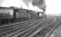 A pair of hard working Jubilee 4-6-0s take an unidentified summer Saturday service south out of Carlisle on 23 September 1961. The Upperby based locomotives are 45696 <I>Arethusa</I> leading 45681 <I<>Aboukir</I>. [See image 47691]