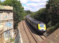 Graffiti is unusual in Bath, but the building on the left is uninhabited. In July 2018 it seemed to be under rather slow restoration. The Westbound HST may have a less promising future.<br><br>[Ken Strachan 31/07/2018]