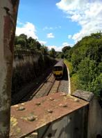 Another atypical view of Bath, looking the other way from See image [[66554]]. An eastbound Sprinter passes the retaining wall for the Avon Canal in July 2018.<br><br>[Ken Strachan 31/07/2018]