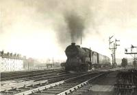 ^Director^ class 4-4-0 no 62689 <I>Maid of Lorn</I> photographed at the head of a local train passing Cowlairs West Junction on 22 September 1955.