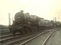 Weekend locomotive lineup at Eastfield shed on Saturday 21 July 1951. Nearest the camera is ^Crab^ 2-6-0 42749, then J36 0-6-0 65221, then K2 2-6-0 61794 <I>Loch Oich</I>.